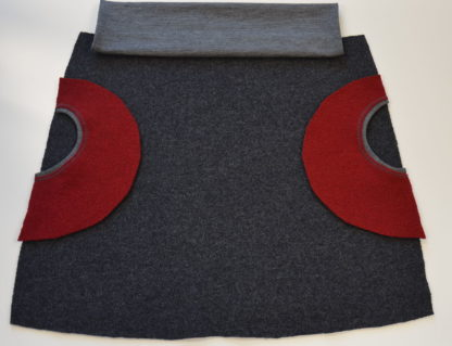 sukna Oamaru z merina s cervenymi vreckami